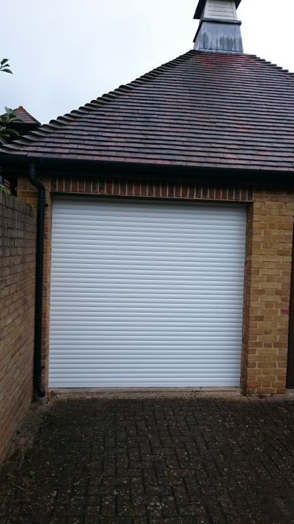 Compact 55 DM roller garage door, roll housing above lintel and guide rail fitted behing piers