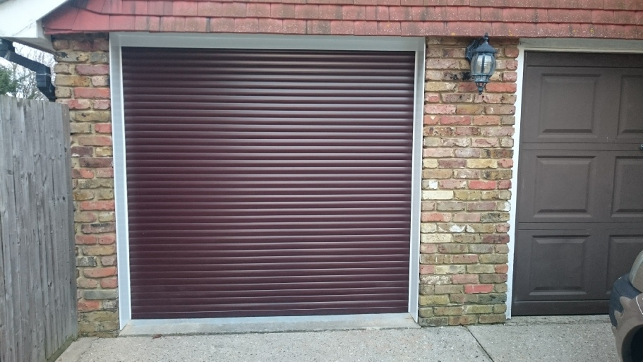 Compact 55 roller door in rosewood finish, white frame and white cladding to reveals and lintel.