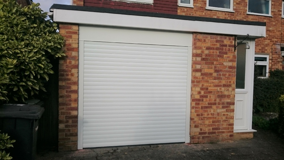 White Compact 55 roller garage door, under lintel and between piers